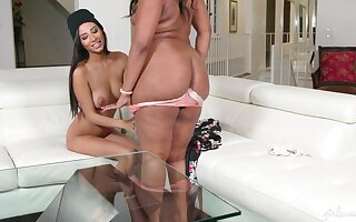 Lesbian interracial on the bed between Chanell Heart and Gianna Dior