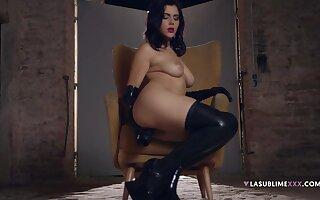 Solo model Valentina Nappi sucks a fat dildo and penetrates herself