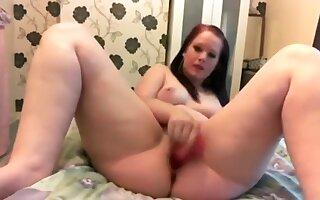 Chubby redhead girl masturbates with a dildo and moans
