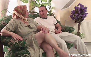 Dirty granny with huge saggy soul fucks a young tramp