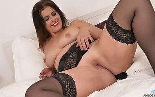 Oversexed cougar Montse Swinger enjoys effectuation with a pink dildo