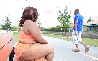 Chubby ebony shoves huge cock helter-skelter her fat ass